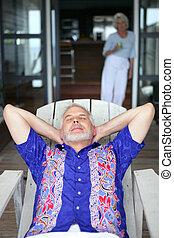 Senior man relaxing on a veranda
