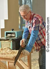 Senior man  repairing in the room