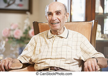 Senior man resting in armchair