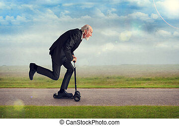 senior man riding a scooter