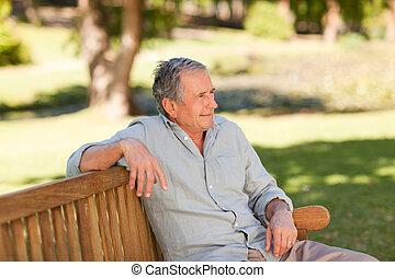 Senior man sitting on a bench