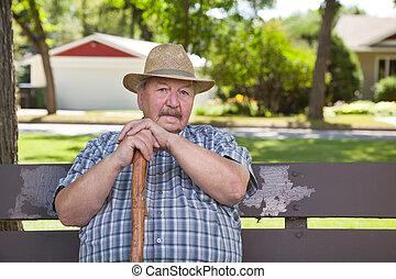 Senior man sitting on park bench