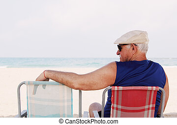 Senior man Sitting On the Beach