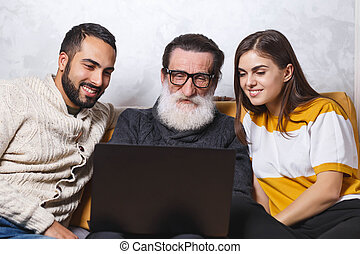 Senior Man Sitting With His Children