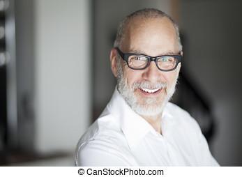 Senior Man Smiling At The Camera
