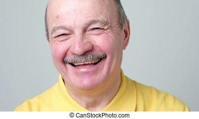 Senior man smiling. Happiness carefree emotional concept....