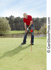 Senior man standing on golf course