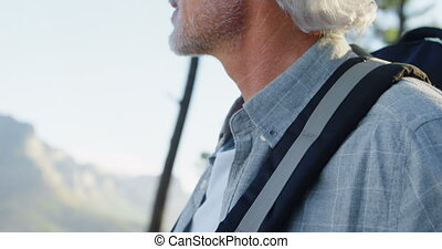 Senior man standing with backpack at countryside 4k -...
