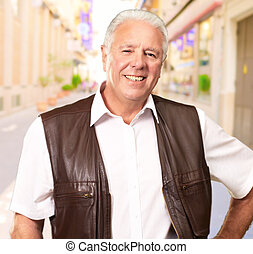 Senior Man Standing With Hand On Hips, Outdoor