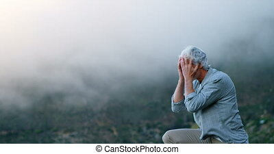 Senior man standing with hands on hair at counytryside 4k -...