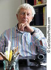 Senior man - Senior gentleman age 78 wearing a hearing aid...
