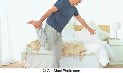 Senior man stretching himself