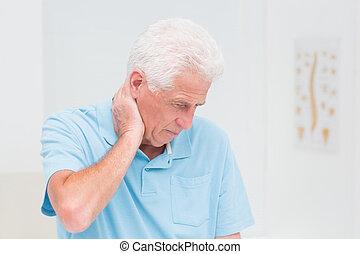 Senior man suffering from neck ache