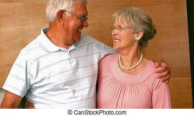 Senior man surpising partner with f