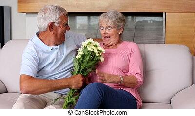 Senior man surprising partner with