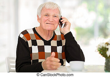 senior man talking on cell phone - cheerful senior man...
