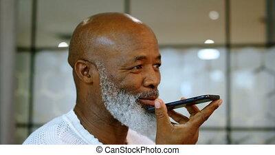 Senior man talking on mobile phone 4k