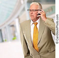 Senior Man Talking On Phone