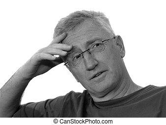Senior man thinking, isolated