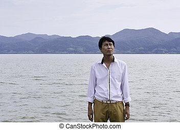 Senior Man Thinking On Beach