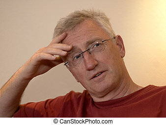 Senior man thinking about something