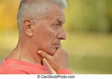 Senior man thinking - Portrait of senior man thinking about...