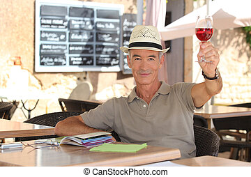 78da6e452b87b 65 years old man wearing a straw hat and drinking a tea cup on a ...