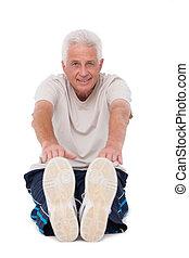 Senior man touching his toes