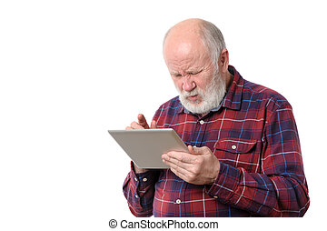 Senior man touching something at tablet computer screen,...