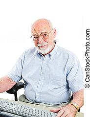 Senior Man Using Desktop Computer