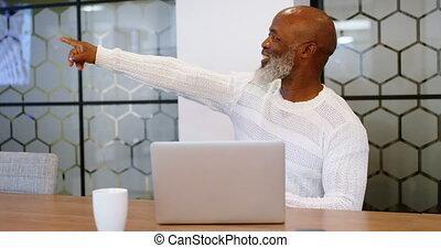 Senior man using digital tablet in conference room 4k -...