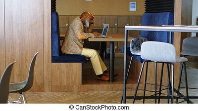 Senior man using laptop 4k