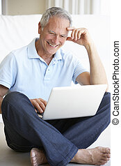 Senior man using laptop computer