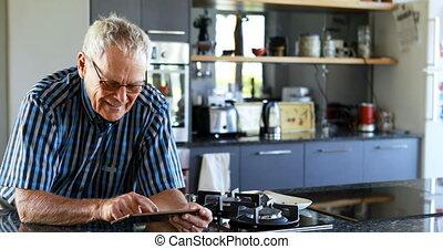 Senior man using mobile phone in kitchen 4k - Senior man ...