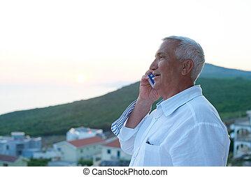senior man using smart phone