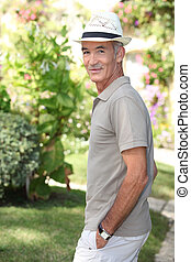 Senior man walking in the garden