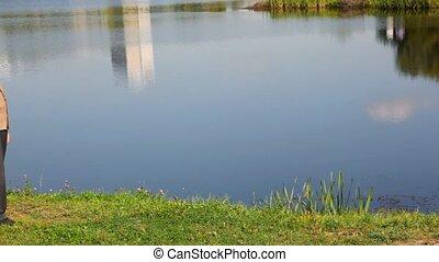 senior man walking past lake - Senior man walking past lake....