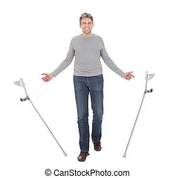 Senior man walking using crutches