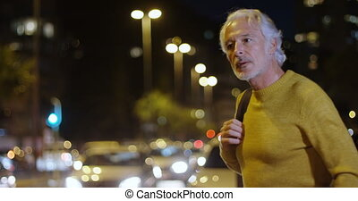 Senior man walking with backpack in the city 4k - Senior man...