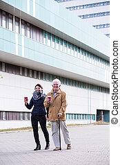 Senior man walking with cane