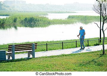 Senior Man Walking with Poles