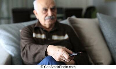 Senior Man Watching Television