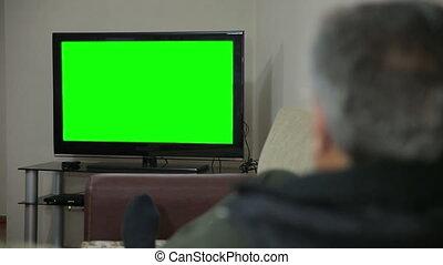Senior man watching TV
