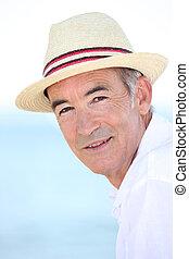 Senior man wearing a summer hat