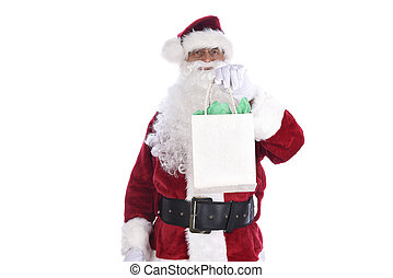 Senior man wearing a traditional Sant Claus costume holding a gift bag in his hand. Isolated on white.