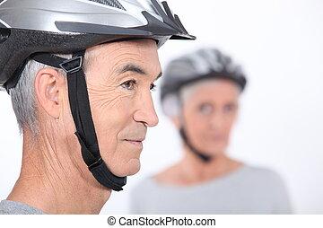 Senior man with a bicycle helmet
