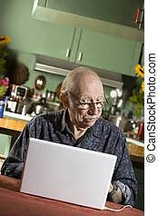 Senior Man with a Laptop Computer