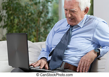 Senior man with a laptop - View of senior man with a laptop