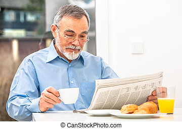 Senior man with a newspaper