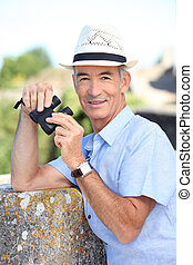 Senior man with a pair of binoculars